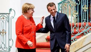 Merkel e Macron se unem por orçamento comum do euro e combate à imigração ilegal