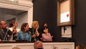 Obra de Banksy no valor de R$ 5,2 milhões se autodestrói após ser leiloada